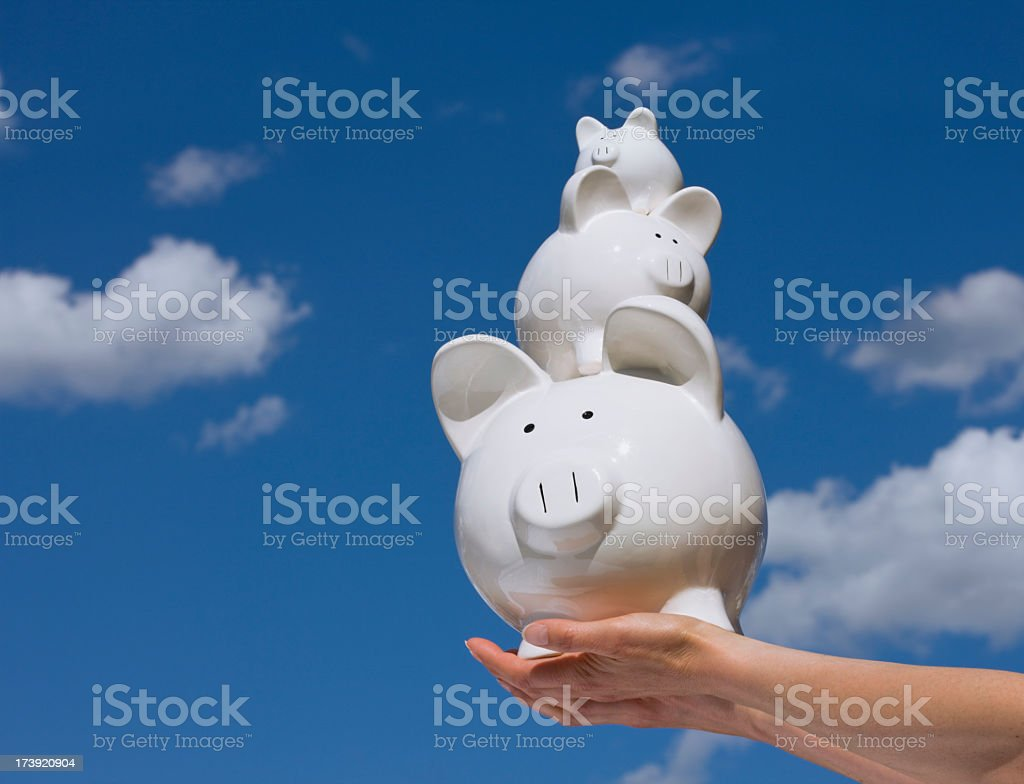 Piggy Banks Against a Blue Sky royalty-free stock photo