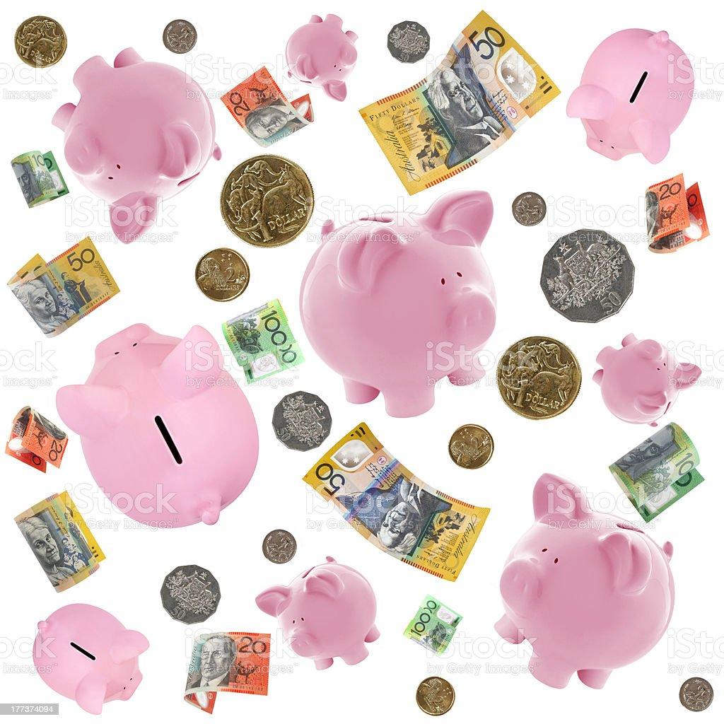 Piggy Banks and Australian Money Falling over White stock photo