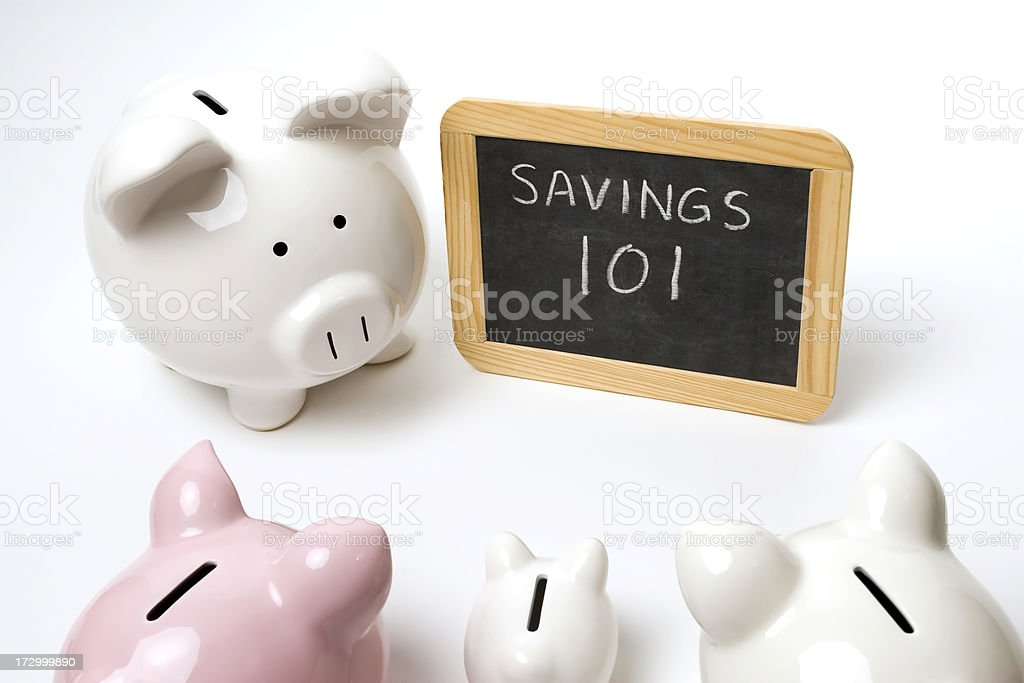 Piggy Banks Learning About Saving Money royalty-free stock photo