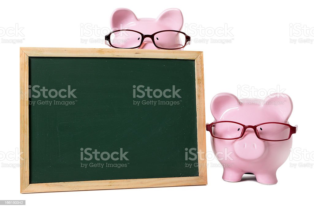 Piggy banks with blank blackboard royalty-free stock photo
