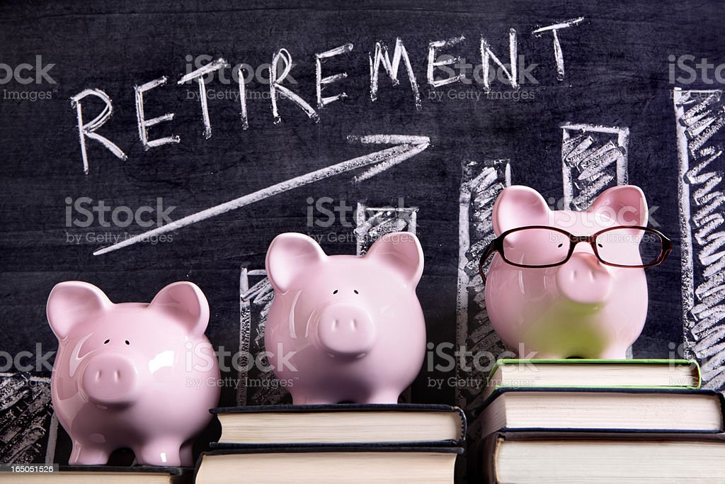 Piggy Banks with retirement savings chart royalty-free stock photo