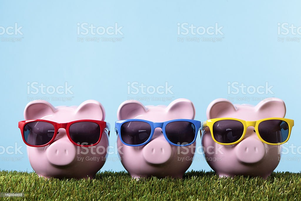 Piggy Banks with sunglasses stock photo
