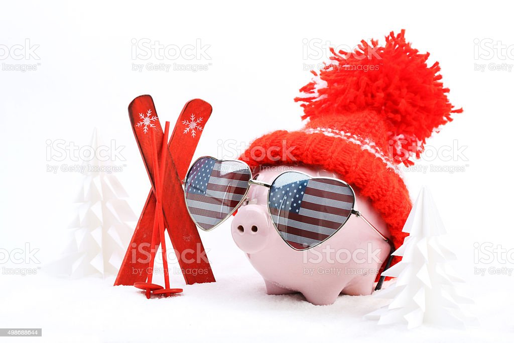 Piggy box with hat with pompom and sunglasses with USA flag stock photo