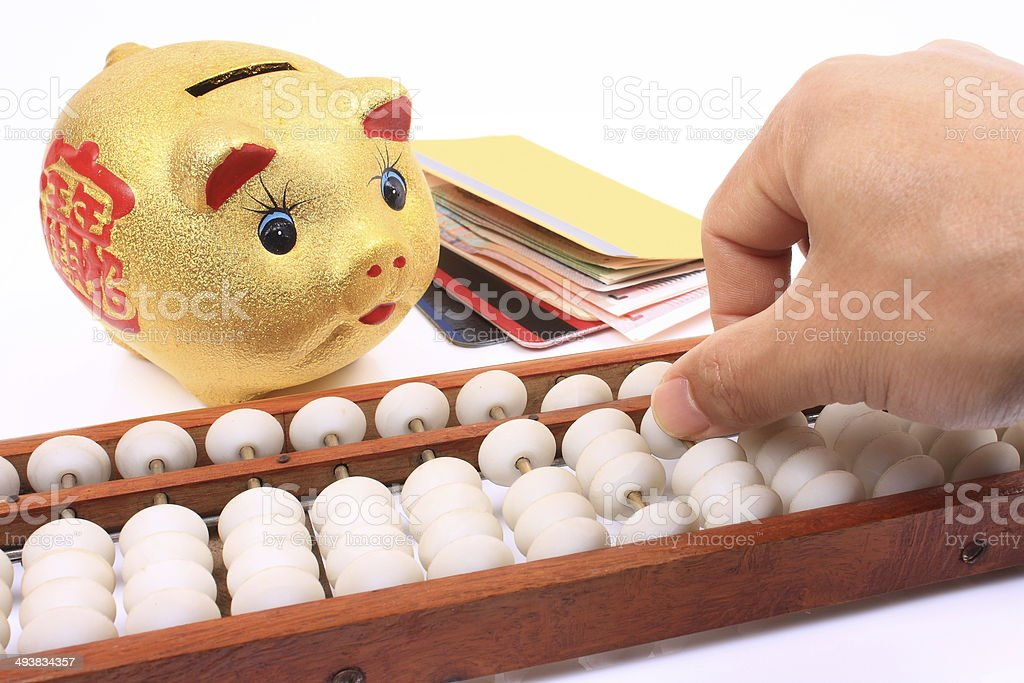 Piggy, money and abacus stock photo