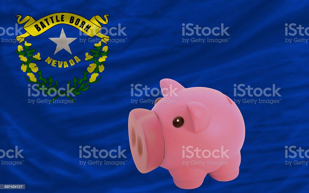 piggy rich bank and flag of american state of nevada stock photo