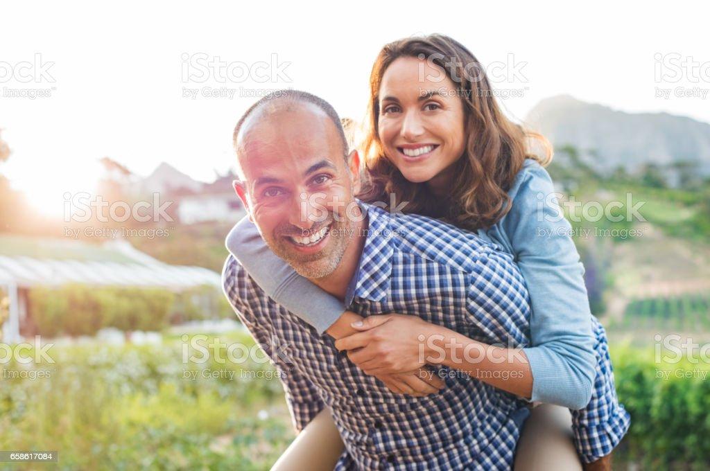 Piggyback mature couple stock photo