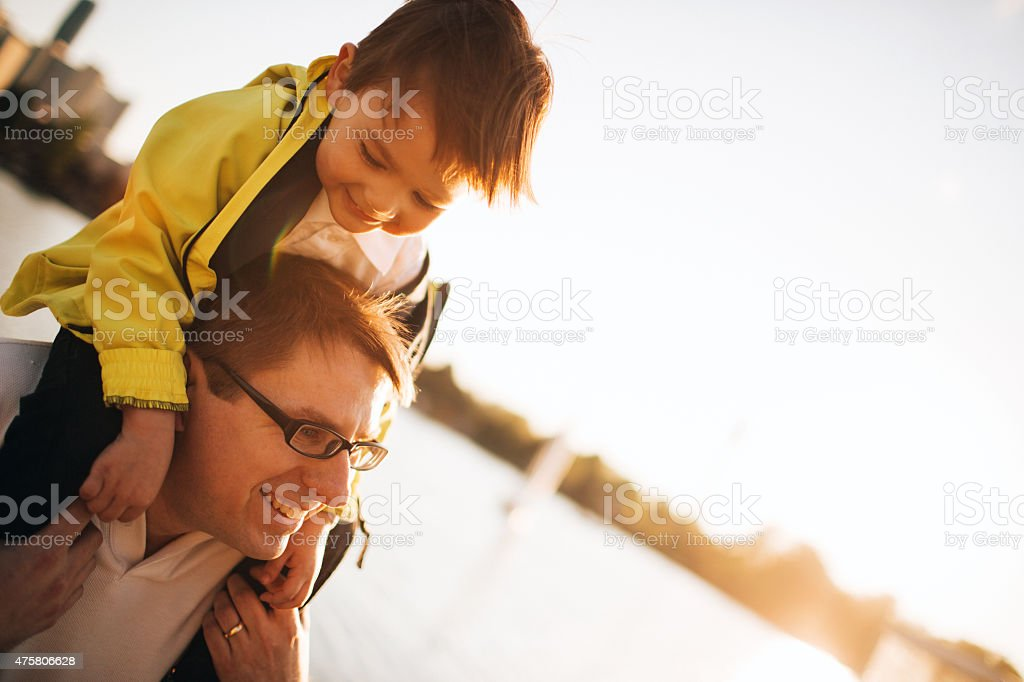 Piggyback ride by the river stock photo