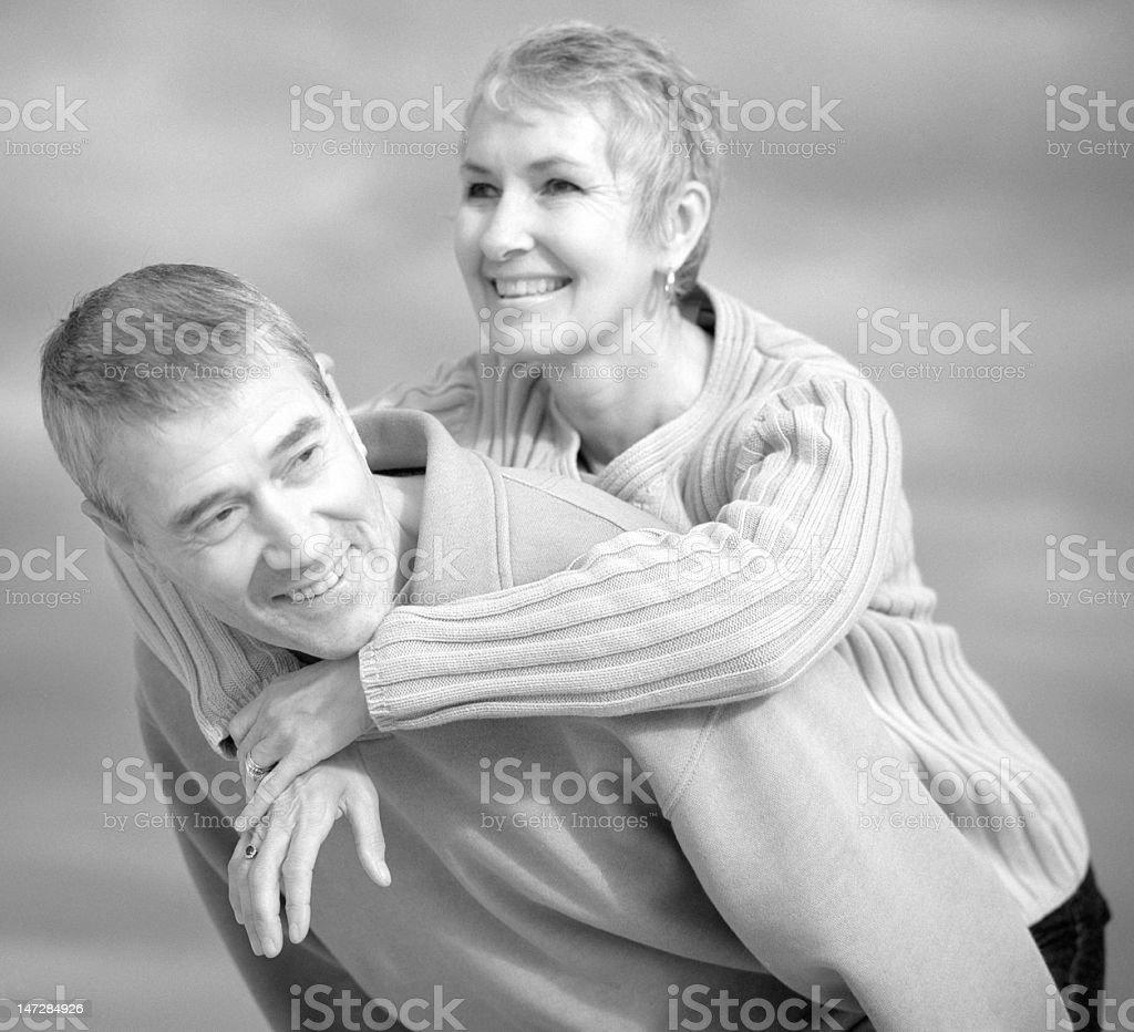 Piggyback ride senior couple royalty-free stock photo