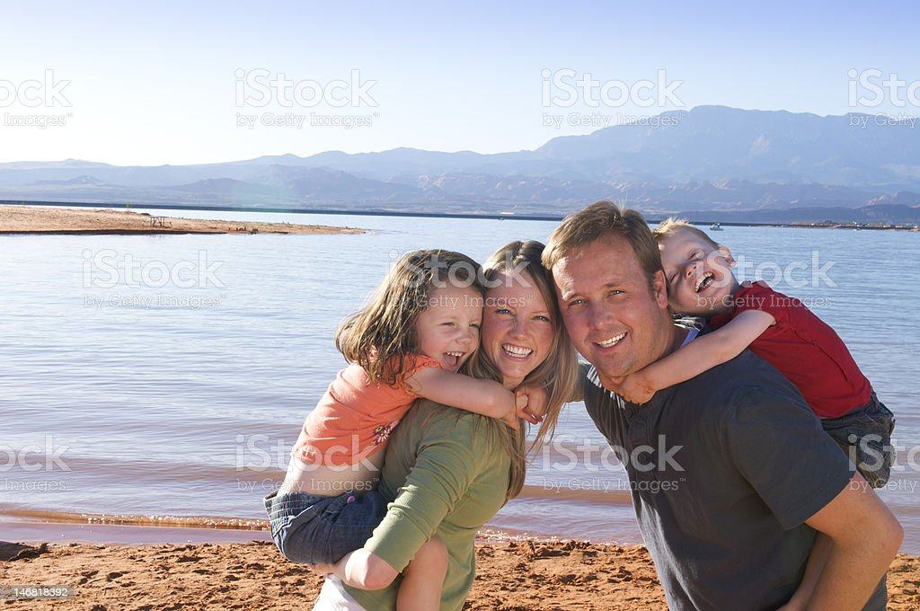 Piggyback rides with mom and dad stock photo