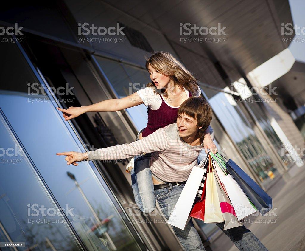 Piggyback shopping stock photo