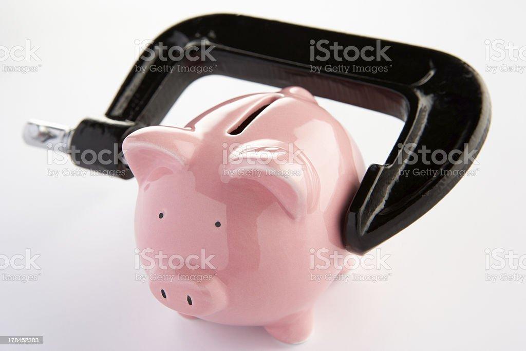Piggybank in a vice stock photo