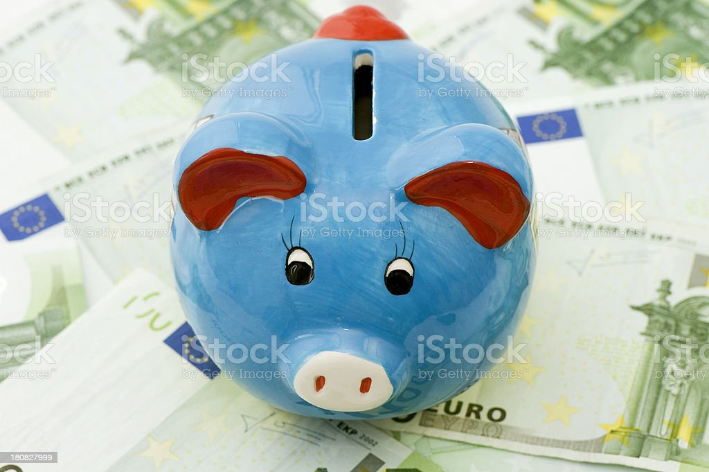 piggybank sitting on 100 euro banknote background royalty-free stock photo
