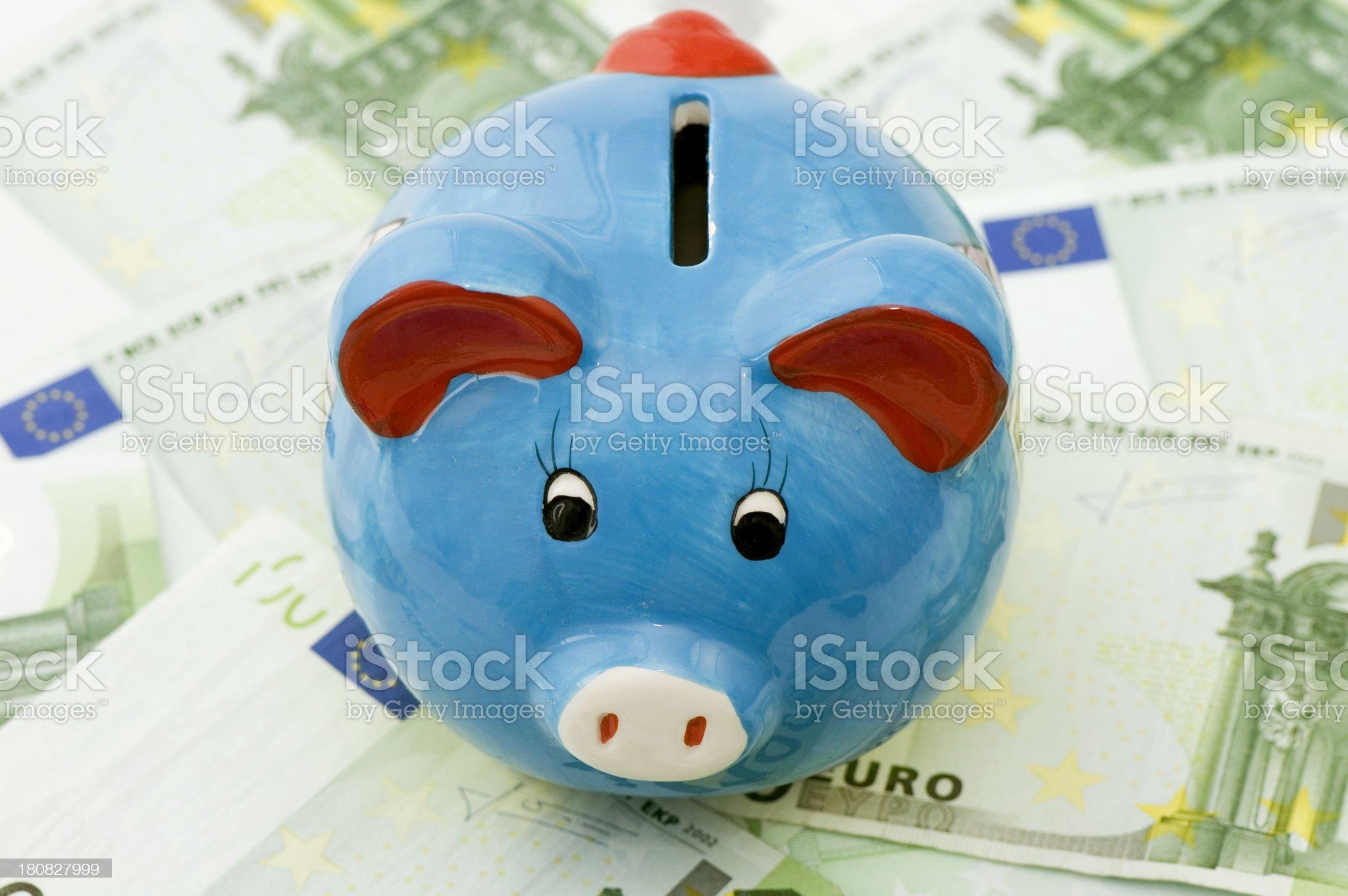 piggybank sitting on 100 euro banknote background royalty-free stock photo