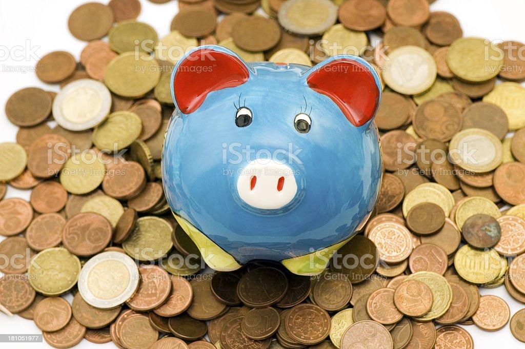 piggybank sitting on euro coins background stock photo
