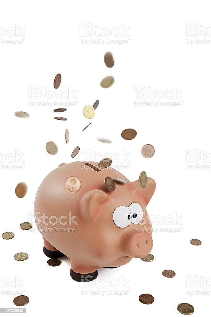 piggybank under a rainfall of coins stock photo