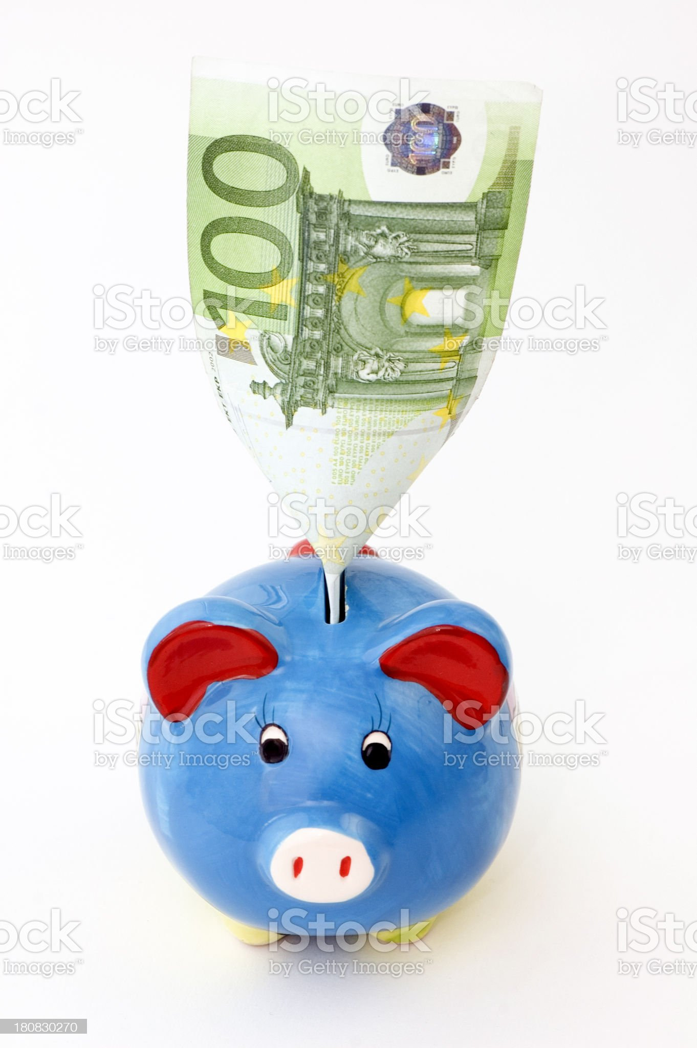 piggybank with 100 euro banknote in slot. royalty-free stock photo