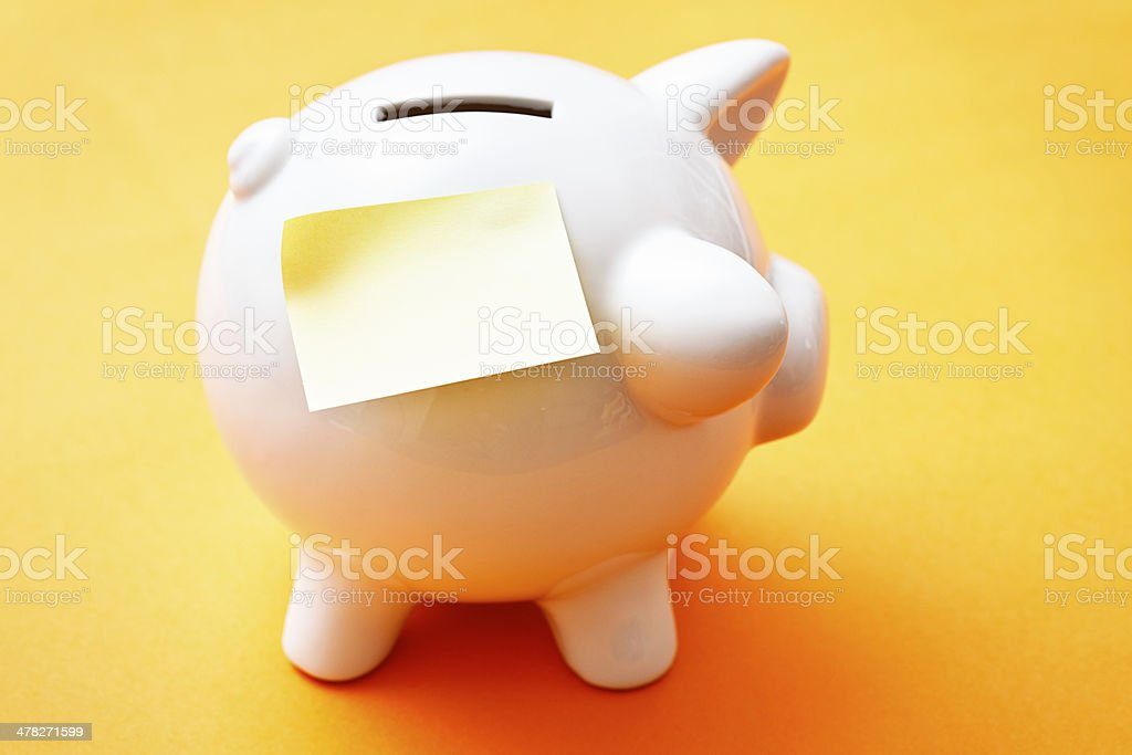 Piggybank with blank label to add your savings target stock photo