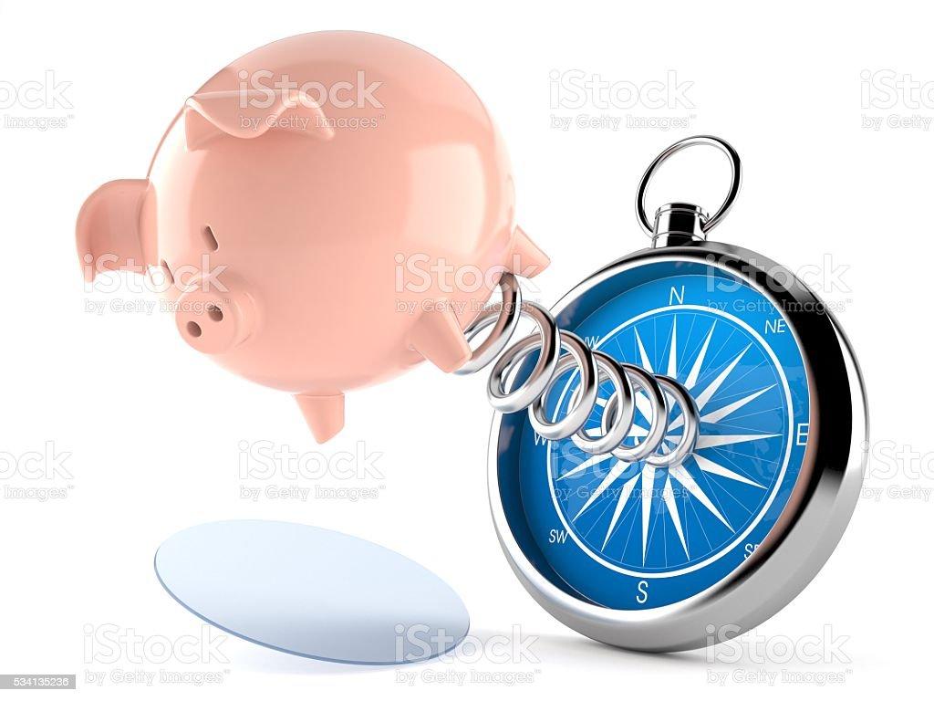 Piggybank with compass stock photo