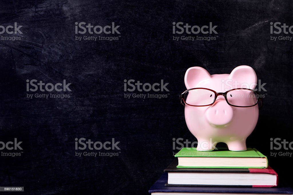 Piggybank with glasses and blackboard stock photo