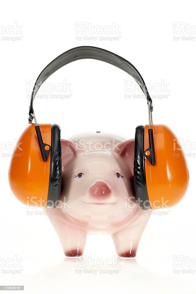 Piggybank with headphones royalty-free stock photo