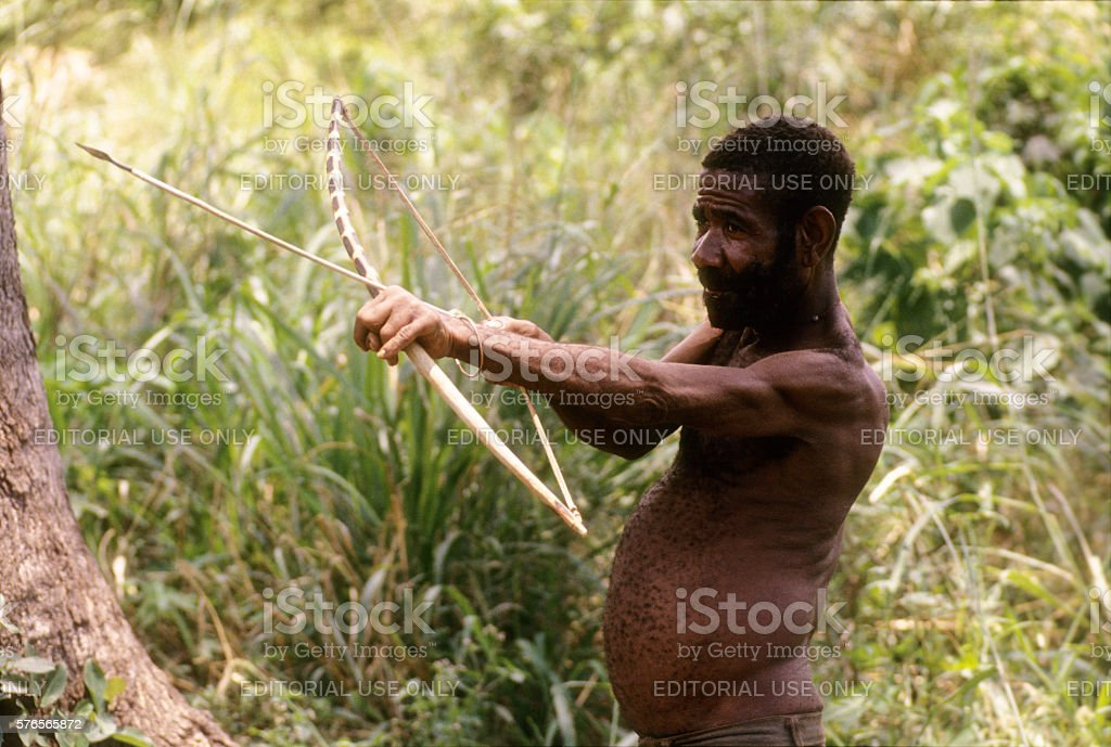 Pigmys with bow and arrow at Semiliki forest, Uganda stock photo