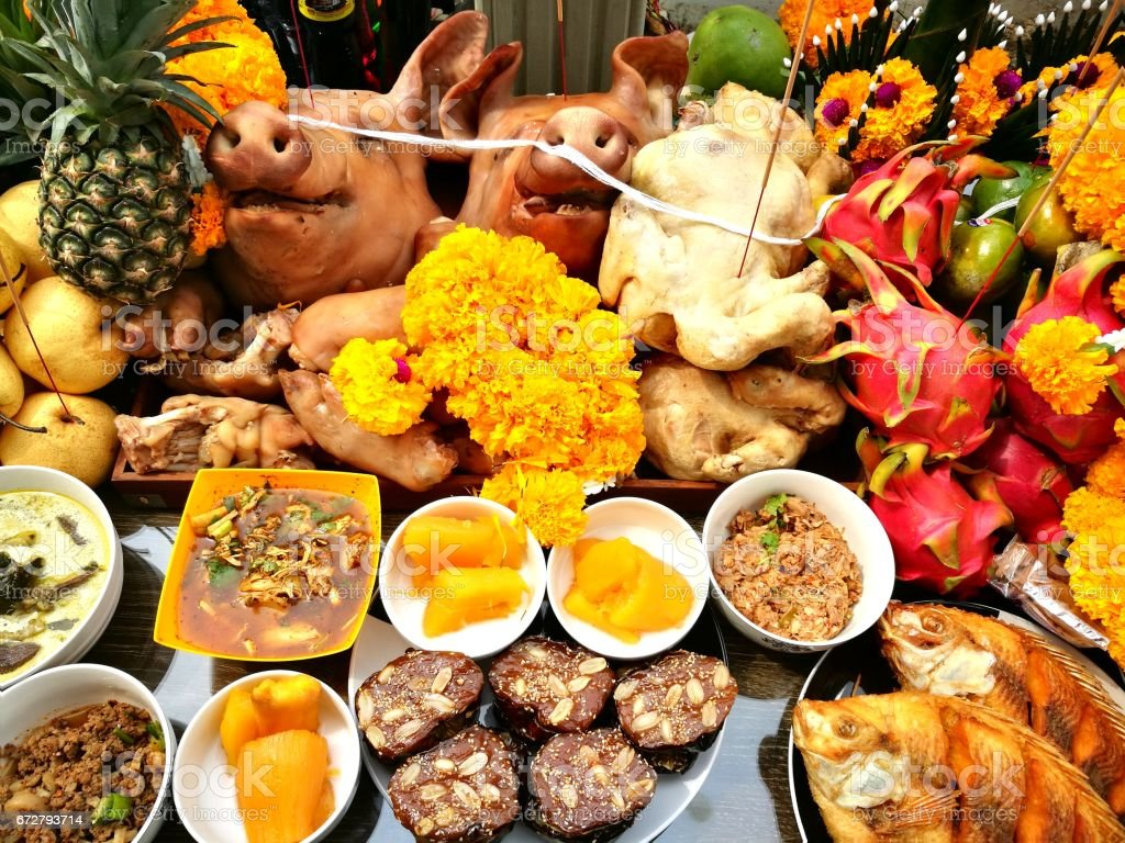 Pig's head and side dish  to worship God is to give Him our love in the Traditions Of Thailand stock photo