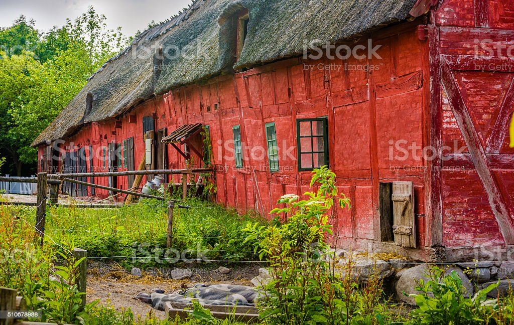 Pigsty at old red timbered building stock photo