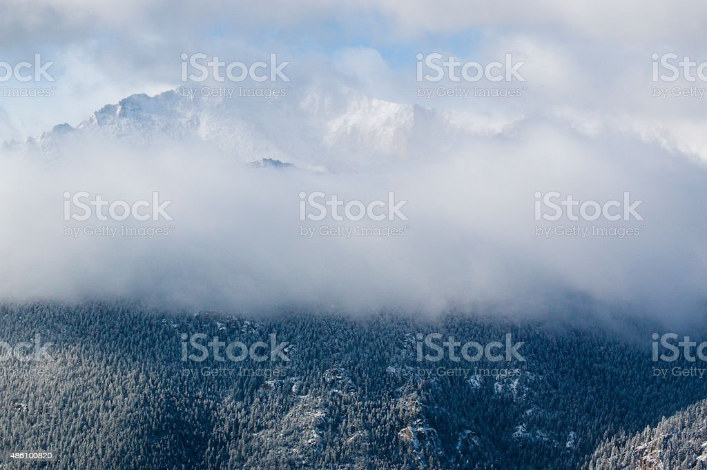 Pikes Peak in Fog and Fresh Snow stock photo