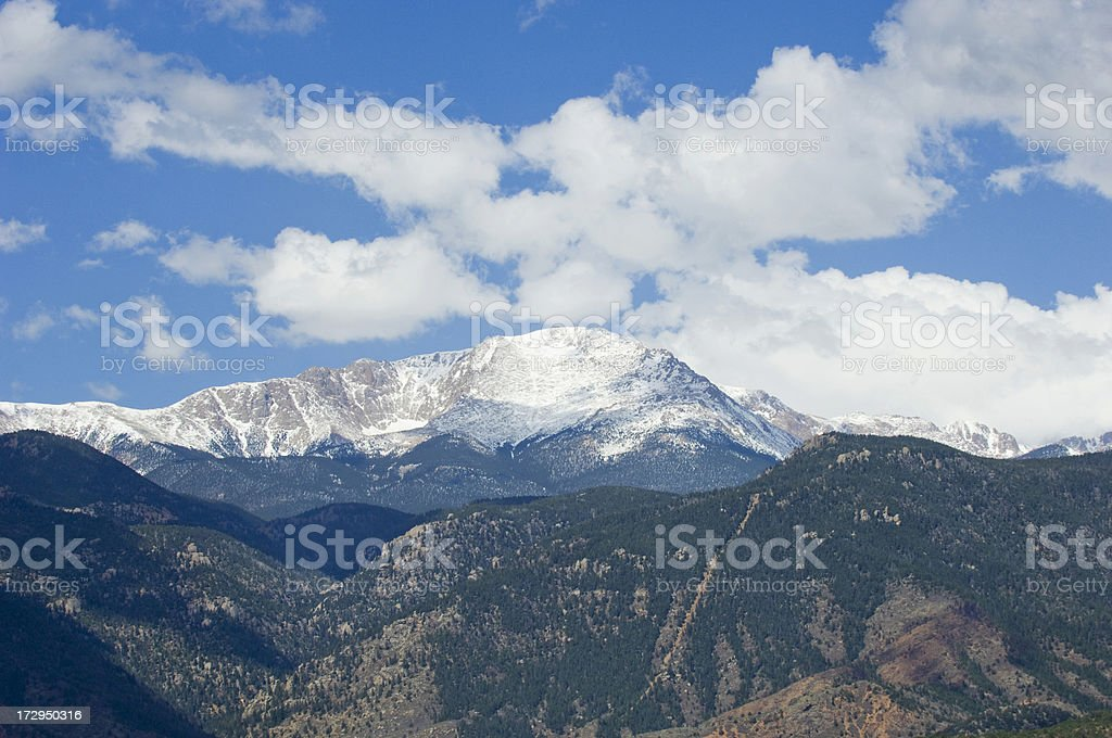 Pikes Peak with Blue Sky and White Clouds stock photo
