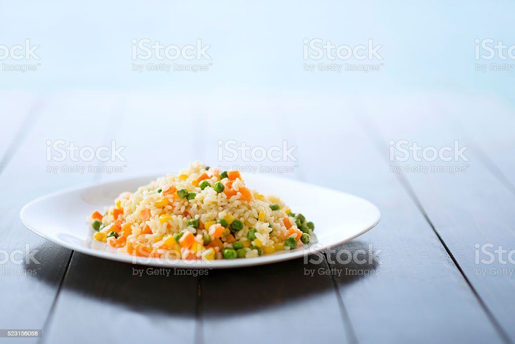 Pilaf Rice with Vegetables on a Plate by the Sea stock photo