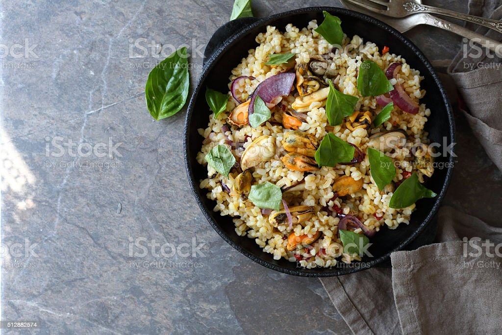 pilaf with bulgur and mussels stock photo