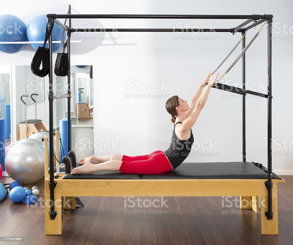 Pilates aerobic instructor woman in cadillac stock photo