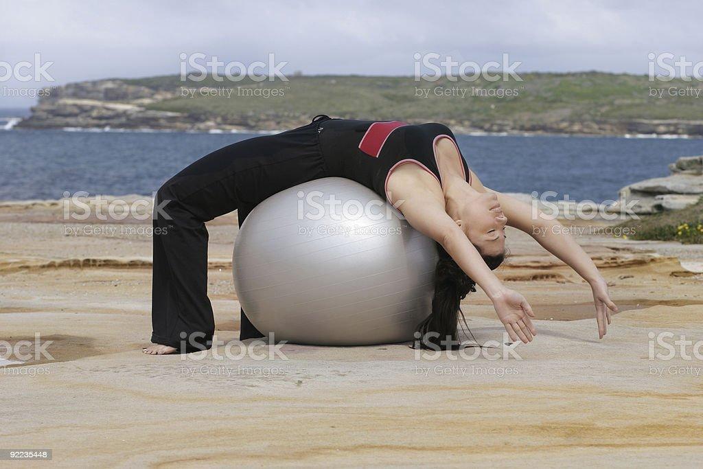 Pilates - ball stretch backwards royalty-free stock photo
