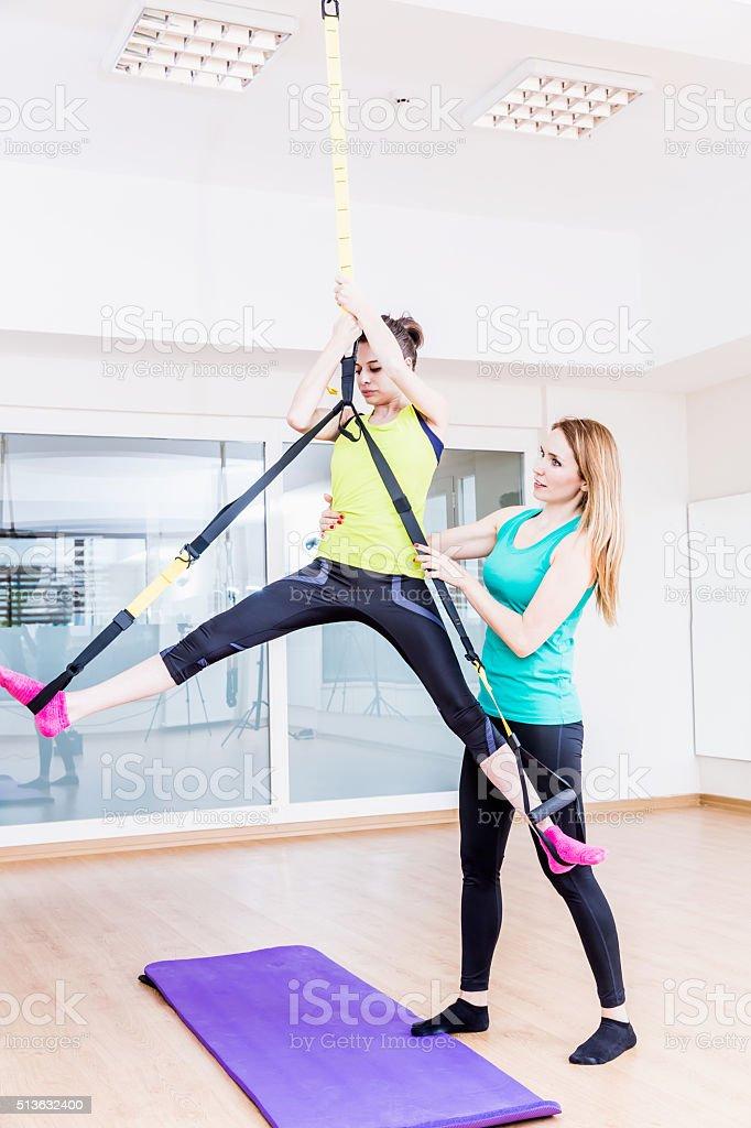 Pilates Class - TRX training stock photo