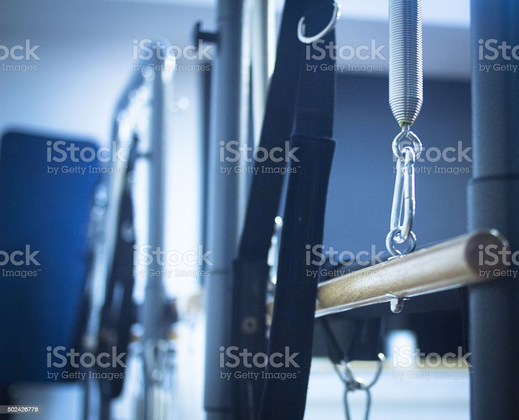 Pilates exercise fitness gym machine in health club stock photo
