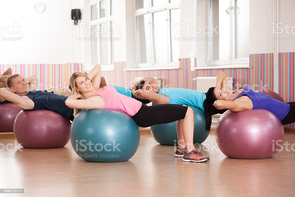 Pilates exercise with fitness balls stock photo