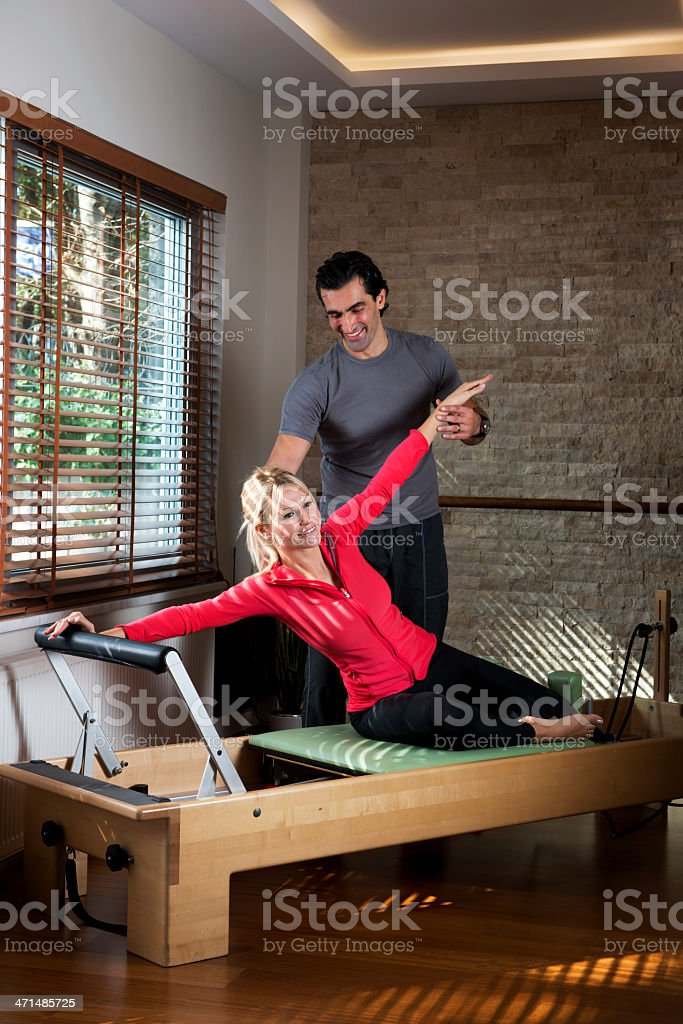 Pilates Exercise with instructor royalty-free stock photo