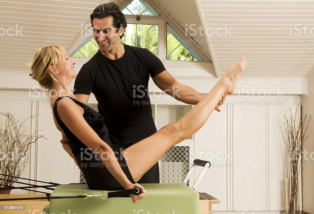 Pilates Exercise with instructor stock photo