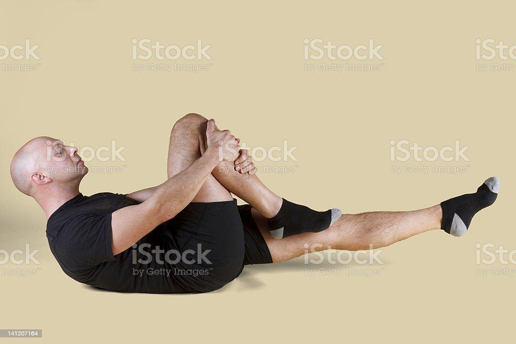 Pilates Position - Single Leg Stretch royalty-free stock photo