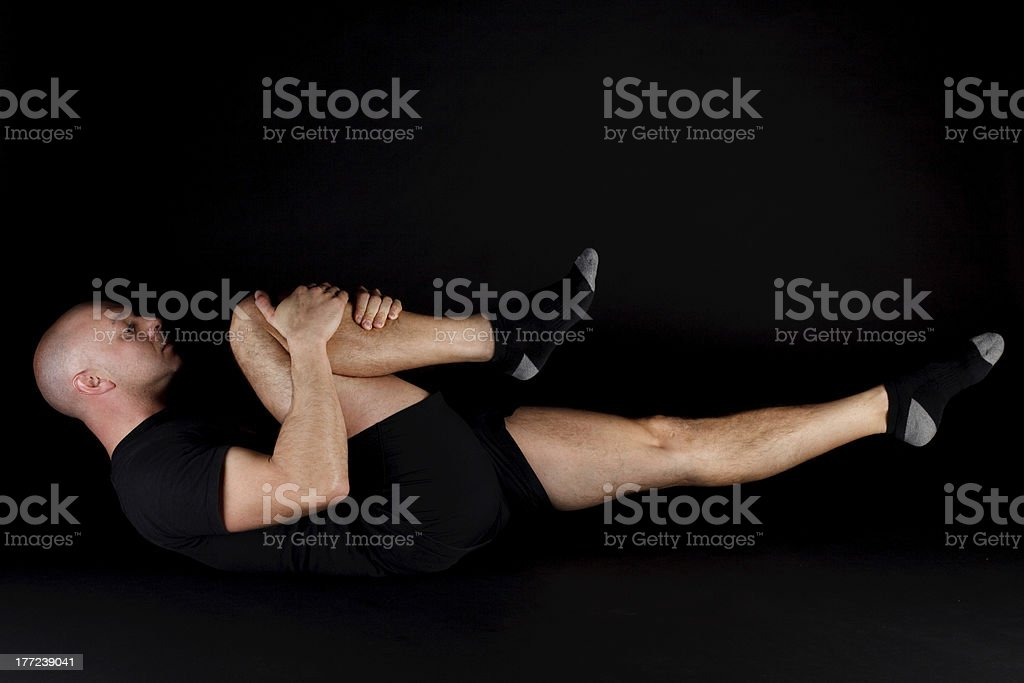 Pilates Position - Single Leg Stretch royalty-free stock photo
