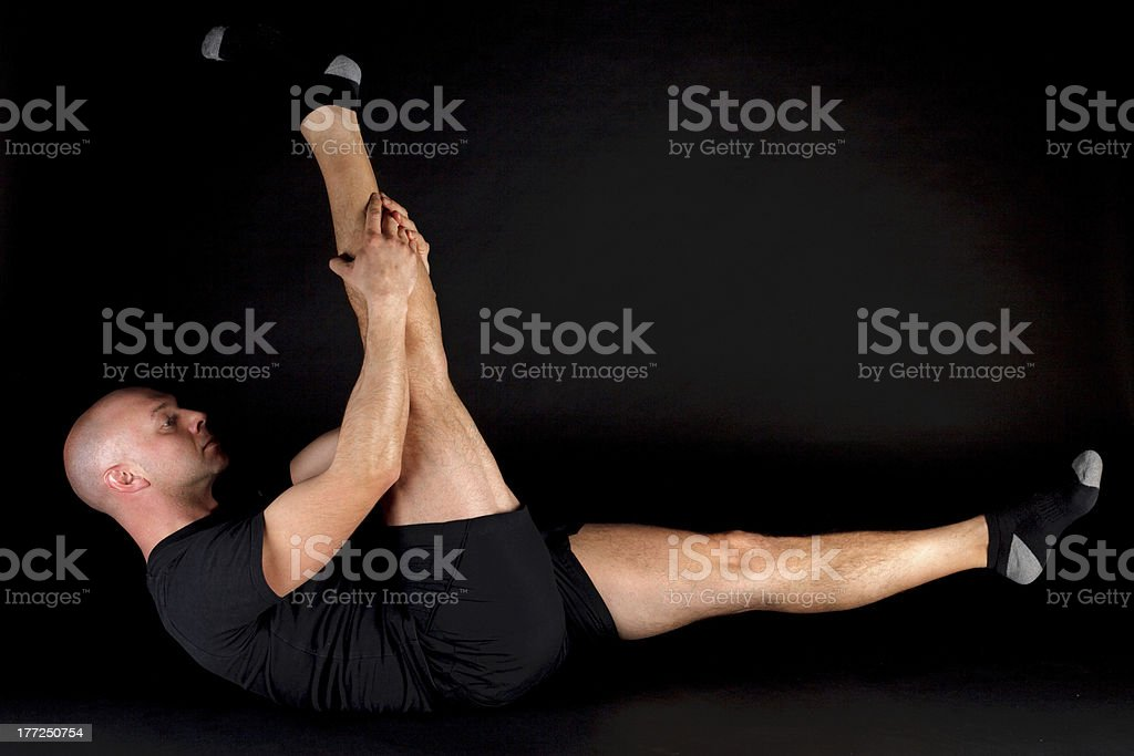 Pilates Position - Single Straight Leg royalty-free stock photo