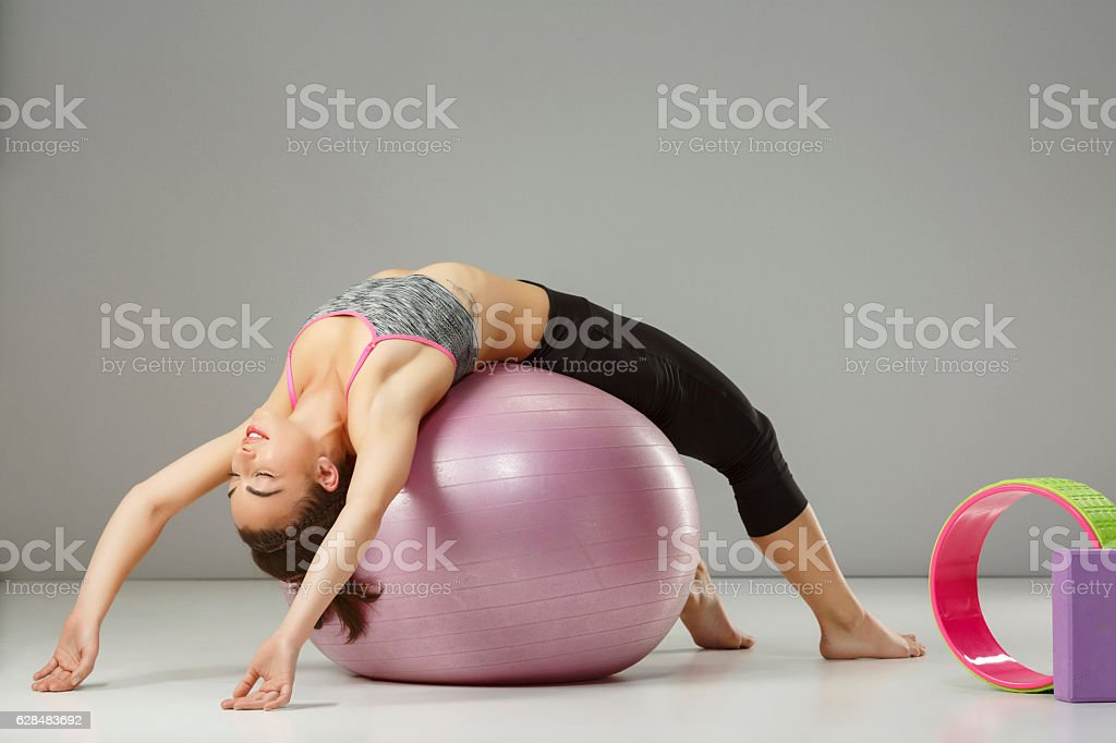 Pilates stretching  training   Woman practicing on a fitness ball stock photo