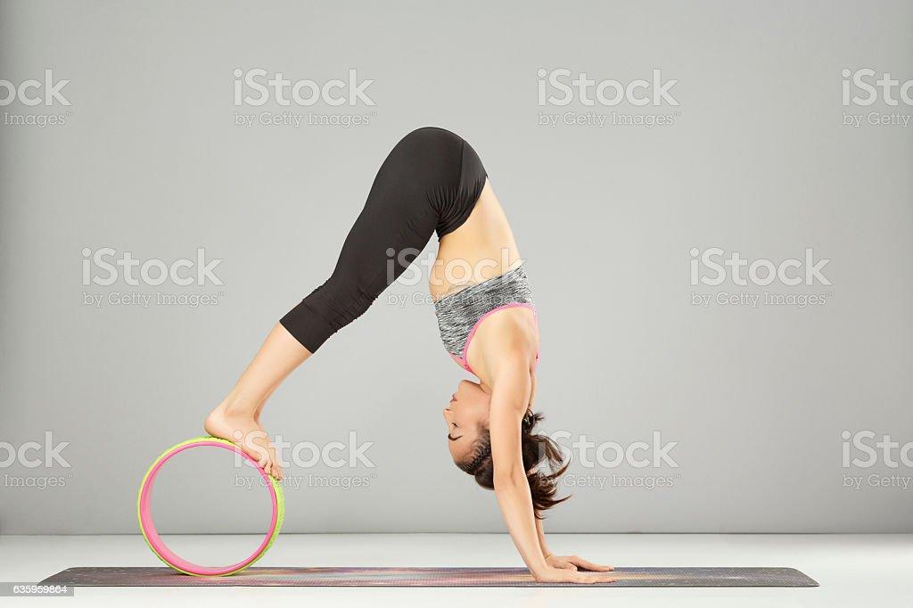 Pilates stretching  training  Yoga wheel poses Woman practicing advanced yoga stock photo