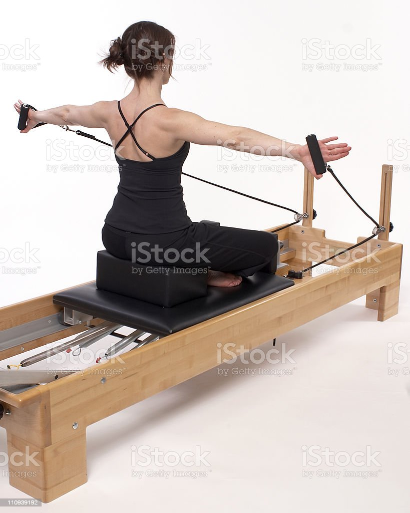 Pilates Woman on Reformer Arms Out royalty-free stock photo