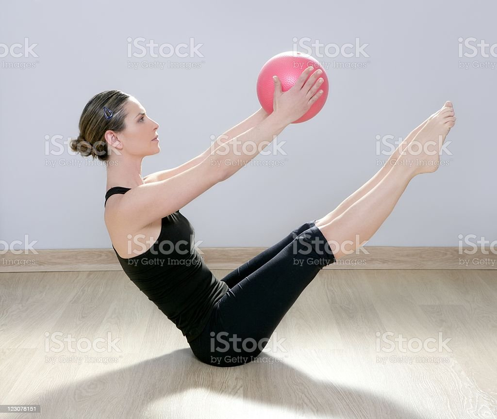 pilates woman stability ball gym fitness yoga stock photo