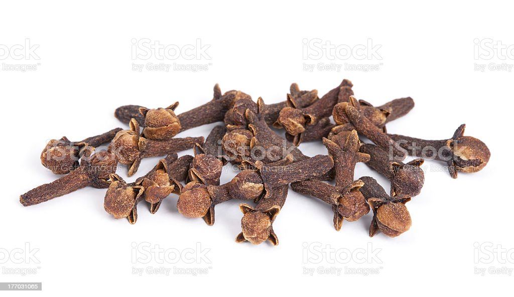 Pile Clove (Syzygium aromaticum) isolated on white background. stock photo