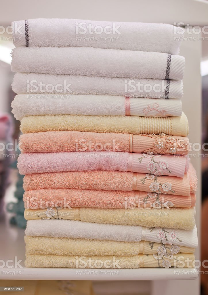 Pile colored of terry towels on the shelf stock photo