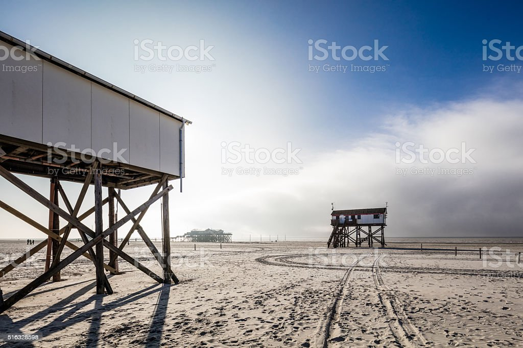 Pile dwellings in St. Peter-Ording, Germany stock photo