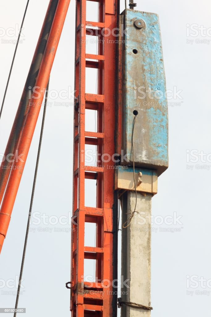 Pile installation by drop hammer. stock photo