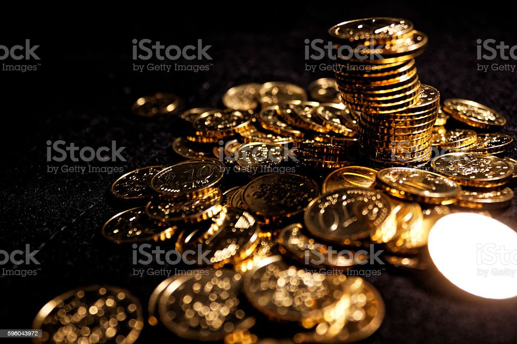 Pile of 10 euro cent coins on black background stock photo
